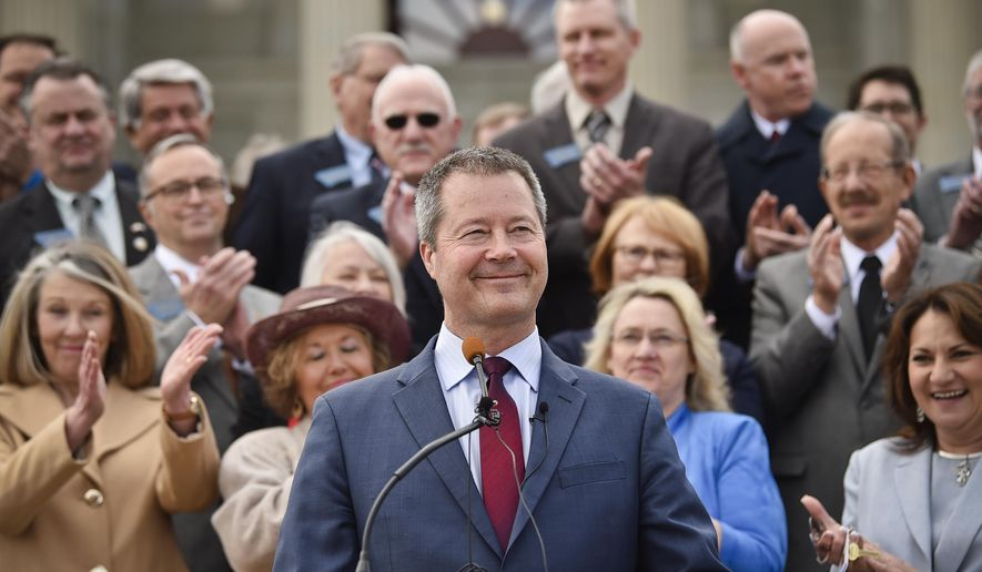 State Sen. Albert Olszewski, who ran in the Republican U.S. Senate primary last year, announces Wednesday, April 3, 2019 he's joining the race for governor in 2020 on the step of the Montana State Capitol in Helena, Mont. (Thom Bridge/Independent Record via AP)