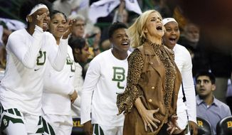 FILE - In this Jan. 3, 2019, file photo, Baylor head coach Kim Mulkey reacts in front of the bench to a blocked shot during an NCAA college basketball game against Connecticut in Waco, Texas. These Lady Bears certainly know how to win, and they're having fun all the way to their first women's NCAA Final Four since 2012. (AP Photo/Ray Carlin, File)