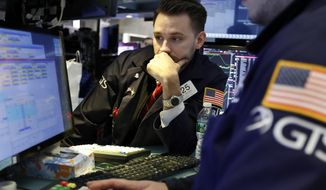 FILE- In this March 5, 2019, file photo specialist Matthew Grenier works on the floor of the New York Stock Exchange. The U.S. stock market opens at 9:30 a.m. EDT on Wednesday, April 3. (AP Photo/Richard Drew, File)