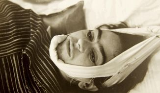 This 1940 photo provided by Sotheby's shows artist Frida Kahlo with her head suspended by straps. The image is part of a collection of photographs by Nicholas Muray up for auction on Friday, April 5, 2019. (Nickolas Muray via Sothebys via AP)
