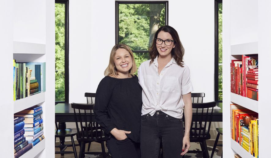 This 2018 photo shows Joanna Teplin, left, and Clea Shearer of The Home Edit at the Nashville home of Shearer. The founders of the Nashville-based company, The Home Edit, do believe in streamlining your belongings to get organized, but say it isn't realistic to expect people to pitch most everything.  (John Shearer/The Home Edit via AP)