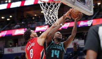 Charlotte Hornets forward Michael Kidd-Gilchrist (14) goes to the basket against New Orleans Pelicans center Jahlil Okafor (8) in the first half of an NBA basketball game in New Orleans, Wednesday, April 3, 2019. (AP Photo/Gerald Herbert)