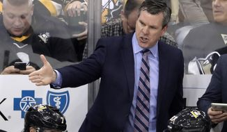 Pittsburgh Penguins head coach Mike Sullivan gives instructions during the first period of an NHL hockey game against the Carolina Hurricanes in Pittsburgh, Sunday, March 31, 2019. (AP Photo/Gene J. Puskar)