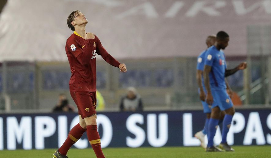 Roma's Nicolo Zaniolo, left, celebrates after scoring his side's opening goal during the Serie A soccer match between Roma and Fiorentina at the Rome Olympic stadium, Wednesday, April 3, 2019. (AP Photo/Andrew Medichini)