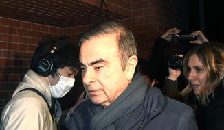 In this April 3, 2019, photo, former Nissan Chairman Carlos Ghosn returns to his residence in Tokyo. Japanese prosecutors took Ghosn for questioning Thursday, April 4, 2019, barely a month after he was released on bail ahead of his trial on financial misconduct charges. (Mizuki Ikari/Kyodo News via AP)