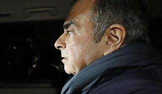 In this April 3, 2019 photo, former Nissan Chairman Carlos Ghosn in a car leaves his lawyer's office in Tokyo. Japanese prosecutors took Ghosn for questioning Thursday, April 4, 2019, barely a month after he was released on bail ahead of his trial on financial misconduct charges. (Takuya Inaba/Kyodo News via AP)