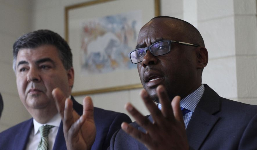 Carlos Velasquez , left, of VDA Trial Lawyers in Florida, USA looks on as Laban Opande of Laban Opande Attorneys & Counselors of Law from Texas, USA , gestures during a press conference, at the Intercontinental hotel, in Nairobi, Kenya, Wednesday April 3, 2019. A U.S. based attorney says eight Kenyan families of victims who died in an Ethiopian Airways crash last month will sue Boeing, the manufacture of the plane, and the airline for compensation. (AP Photo)