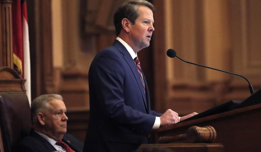 Georgia Gov. Brian Kemp, right, speaks to members of the Georgia House as House Speaker David Ralston looks on during the final 2019 legislative session at the State Capitol Tuesday, April 2, 2019, in Atlanta. (AP Photo/John Bazemore)
