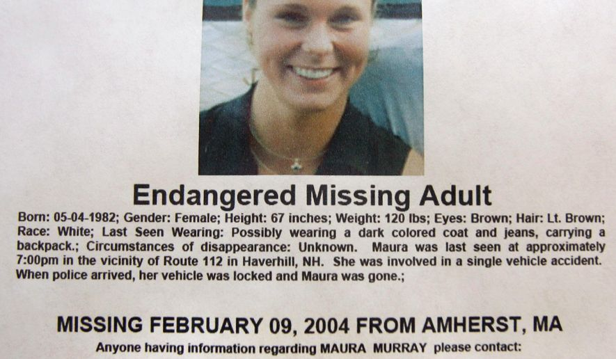 FILE - This Feb. 4, 2014 photo shows a missing person poster of Maura Murray that hangs in the lobby of the police station in Haverhill, N.H. Authorities are in an area of the northern New Hampshire town on Wednesday, April 3, 2019, related to an ongoing investigation into her disappearance in 2004. (AP Photo/Jim Cole, File)