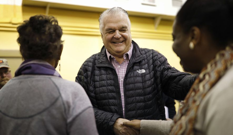 File - In this Jan. 4, 2019, file photo, Nevada Gov.-elect Steve Sisolak, center, shakes hands with Laniesha Dawson, right, at an International Alliance of Theatrical Stage Employees union hall in Las Vegas. For decades, enacting collective bargaining for state workers has remained an elusive goal of supportive Nevada lawmakers. But Democrats this session appear poised to make it a reality, with strong majorities in both legislative chambers and the first Democratic governor in two decades. (AP Photo/John Locher, File)
