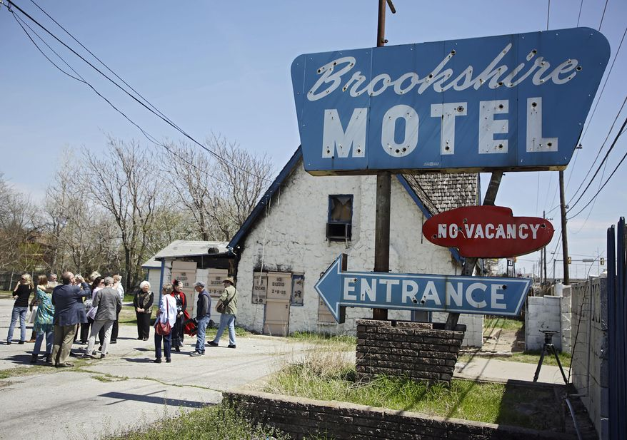 Dignitaries and Route 66 enthusiasts tour the Brookshire Motel site in Tulsa during a tour of Route 66 Tuesday, April 2, 2019. (Mike Simons/Tulsa World/Tulsa World via AP)