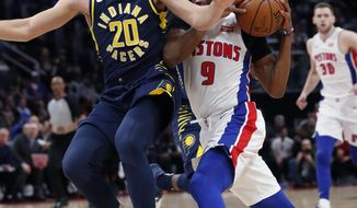 Detroit Pistons guard Langston Galloway (9) drives around Indiana Pacers forward Doug McDermott (20) during the first half of an NBA basketball game, Wednesday, April 3, 2019, in Detroit. (AP Photo/Carlos Osorio)
