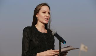 """FILE - In this Feb. 5, 2019 file photo, Angelina Jolie holds a news conference at Kutupalong refugee camp in Cox's Bazar, Bangladesh.  Jolie is not ruling out running for public office.  The 43-year-old actress and U.N. special envoy tells People magazine """"never say never!"""" However, Jolie says she's """"looking to others for leadership.""""  In her role with the U.N.'s High Commission for Refugees, Jolie recently urged nations to deploy more women peacekeepers in order to prevent sexual violence against refugees. Jolie says """"we have to change laws that treat women as second-class citizens.""""  (AP Photo, File)"""