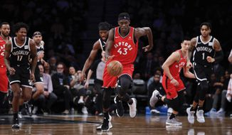 Toronto Raptors forward Pascal Siakam, center, dribbles the ball down court during the first half of an NBA basketball game Wednesday, April 3, 2019, in New York. (AP Photo/Kevin Hagen)