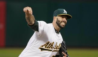 Oakland Athletics starting pitcher Mike Fiers (50) throws against the Boston Red Sox during the first inning of a baseball game in Oakland, Calif., Tuesday, April 2, 2019. (AP Photo/Tony Avelar)