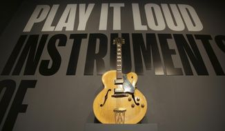 """A guitar played by Chuck Berry is displayed at the entrance to the exhibit """"Play It Loud: Instruments of Rock & Roll"""" at the Metropolitan Museum of Art in New York, Monday, April 1, 2019. The exhibit, which showcases the instruments of rock and roll legends, opens to the public on April 8 and runs until Oct. 1, 2019. (AP Photo/Seth Wenig)"""