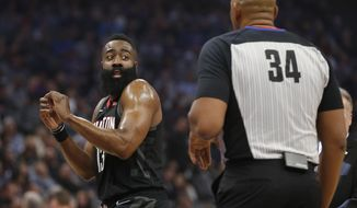 Houston Rockets guard James Harden, left, reacts to a play as he questions referee Kevin Cutler about a foul call during the first quarter of an NBA basketball game against the Sacramento Kings, Tuesday, April 2, 2019, in Sacramento, Calif.(AP Photo/Rich Pedroncelli)