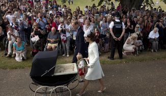 FILE - This July 5, 2015 file photo shows Britain's Prince William, Kate the Duchess of Cambridge, with son Prince George and daughter Princess Charlotte in a pram as they arrive for Charlotte's Christening at St. Mary Magdalene Church in Sandringham, England. Silver Cross, founded in 1877, has been bouncing royal babies in their fancy prams since the birth of King George VI. Prince Charles got around in one when he was born and now the three children of Prince William and the Duchess of Cambridge, Kate Middleton, have shared their Silver Cross ride. (AP Photo/Matt Dunham, File)