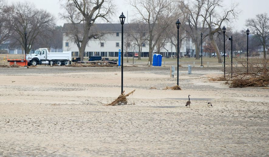 Recent floodwaters from the Platte River filled the Nebraska National Guard's primary training base, Camp Ashland, with sand, water and debris Thursday, March 28, 2019, near Ashland, Nebraska. (Ryan Soderlin/Omaha World-Herald via AP)