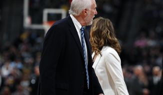 San Antonio Spurs head coach Gregg Popovich argues with referee after being ejected in the first half of an NBA basketball game against the Denver Nuggets Wednesday, April 3, 2019, in Denver. (AP Photo/David Zalubowski)