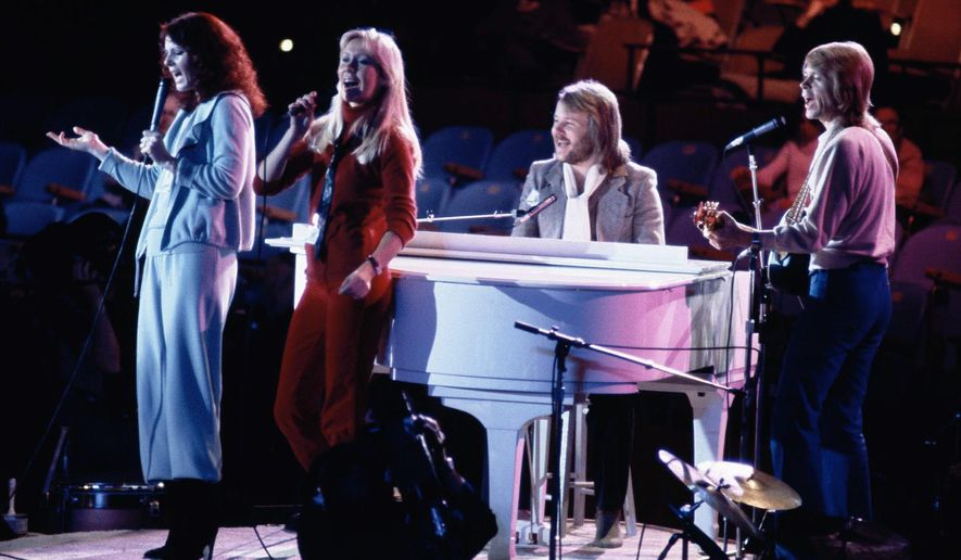 """FILE - In this file photo dated Tuesday Jan. 9, 1979, Abba perform at United Nations General Assembly, in New York, during taping of NBC-TV Special, """"The Music for UNICEF concert.""""  ABBA that had a legendary string of hits after winning the 1974 Eurovision Song Contest, and eventually split up in 1982, are set to release a new song in 2019, according to an interview with Bjorn Ulvaeus published in Denmark's Ekstra Bladet tabloid Wednesday April 3, 2019. (AP Photo/Ron Frehm, FILE)"""