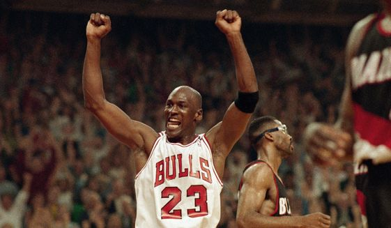 In this June 14, 1992, file photo, Michael Jordan celebrates the Bulls win over the Portland Trail Blazers in the NBA Finals in Chicago. (AP Photo/John Swart) ** FILE **