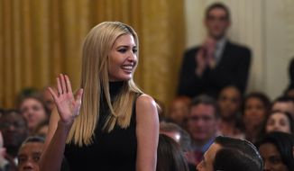 Ivanka Trump, assistant to the president, stands up as she is recognized by President Donald Trump at the 2019 Prison Reform Summit and First Step Act Celebration in the East Room of the White House in Washington, Monday, April 1, 2019. (AP Photo/Susan Walsh)