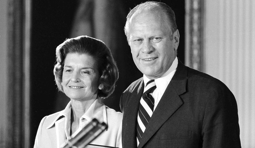 President Gerald R. Ford and first lady Betty Ford smile as they listen to applause after he was sworn in as the nation's chief executive at the White House, Aug. 9, 1974. (AP Photo)