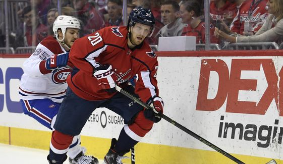 Washington Capitals Lars Eller (20), or Denmark, carries the puck under pressure from Montreal Canadiens Andrew Shaw (65) during the second period of their NHL hockey game in Washington, Thursday, April 4, 2019. (AP Photo/Susan Walsh) ** FILE **