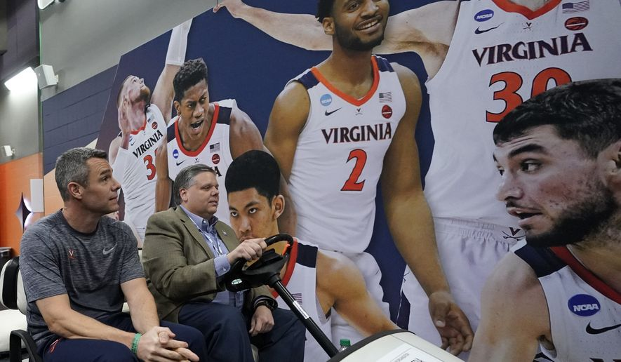 Virginia head coach Tony Bennett looks at a display on the wall as he gets a ride after a practice session for the semifinals of the Final Four NCAA college basketball tournament, Thursday, April 4, 2019, in Minneapolis. (AP Photo/David J. Phillip)