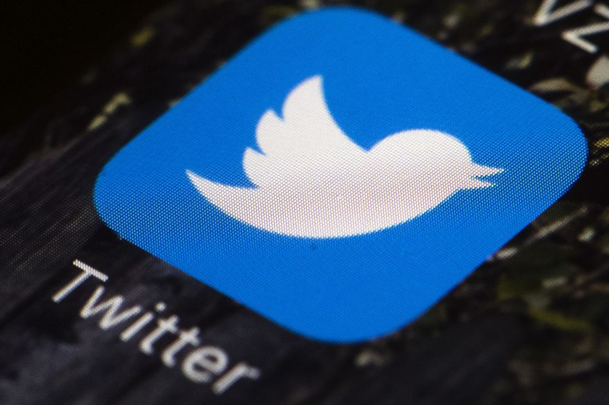 This April 26, 2017 file photo shows the Twitter app icon on a mobile phone in Philadelphia. (AP Photo/Matt Rourke, File)