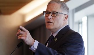 Gov. Jay Inslee addresses a workshop about transportation electrification Thursday, April 4, 2019, in Seattle. The third of four regional workshops, sponsored by the National Governors Association, is to help states develop strategies and improve the planning and deployment of charging infrastructure, as well as electric vehicle (EV) incentive programs. The association representing the 55 governors of states and territories has been working with state and industry leaders to develop and implement best practices across states to accommodate the adoption of electric vehicle technologies. (AP Photo/Elaine Thompson)
