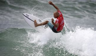 In this March 20, 2019, photo Kelly Slater of the U.S. surfs during his heat in the Sydney Surf Pro at Manly in Sydney, Australia. Slater placed last in his three-man opening heat and was last again in his second-round elimination heat Thursday, April 4, 2019, at the season-opening Quiksilver Pro at Australia's Gold Coast in the World Surf League event which marks the start of Olympic qualifying for surfing. (Dan Himbrechts/AAP Image via AP)
