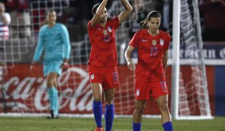 United States forward Alex Morgan, left, gestures to the crowd after scoring a goal as forward Tobin Heath heads down the pitch during the first half of a friendly soccer match against Australia Thursday, April 4, 2019, in Commerce City, Colo. (AP Photo/David Zalubowski)