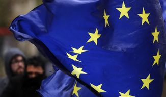 European flags fly, opposite the Houses of Parliament in London, Thursday, April 4, 2019. The British government and senior opposition figures were meeting Thursday in search of a new plan on how the country leaves the European Union as Prime Minister Theresa May tried to stop her shift toward compromise from splitting her Conservative Party. (AP Photo/Frank Augstein)