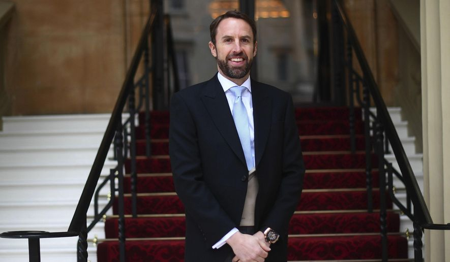 England soccer manager Gareth Southgate arrives for his investiture ceremony at Buckingham Palace, London, Thursday April 4, 2019. (Victoria Jones/Pool Photo via AP)