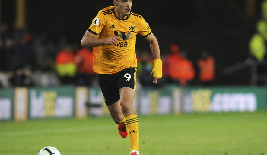 Wolverhampton's Raul Jimenez runs with the ball during the English Premier League soccer match between Wolverhampton Wanderers and Manchester United at the Molineux Stadium in Wolverhampton, England, Tuesday, April 2, 2019. (AP Photo/Rui Vieira)