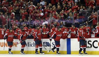 Washington Capitals Lars Eller (20) and his line mates are congratulated after Eller scored a goal during the first period of their NHL hockey game against the Montreal Canadiens in Washington, Thursday, April 4, 2019. The Capitals beat the Canadiens, 2-1. (AP Photo/Susan Walsh)