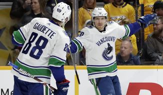 Vancouver Canucks center Markus Granlund (60), of Finland, celebrates with Adam Gaudette (88) after Granlund scored against the Nashville Predators during the first period of an NHL hockey game Thursday, April 4, 2019, in Nashville, Tenn. (AP Photo/Mark Humphrey) ** FILE **