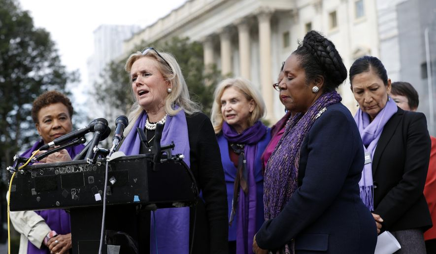 Rep. Debbie Dingell, D-Mich., speaks as Rep. Barbara Lee, D-Calif., left, and Rep. Sheila Jackson Lee, D-Texas, second from right, listen at a news conference after the House voted to reauthorize the Violence Against Women Act, Thursday, April 4, 2019, on Capitol Hill in Washington. At right is Rep. Deb Haaland, D-N.M. (AP Photo/Patrick Semansky)