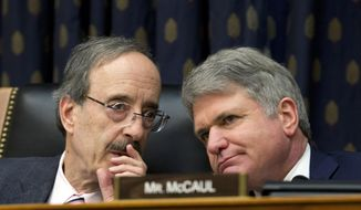 In this Feb. 13, 2019, photo, House Foreign Affairs Committee Chairman Rep. Eliot Engel D-N.Y., left, speaks with Ranking member Rep. Michael McCaul, R-Texas during the House Foreign Affairs subcommittee hearing in Washington. (AP Photo/Jose Luis Magana)