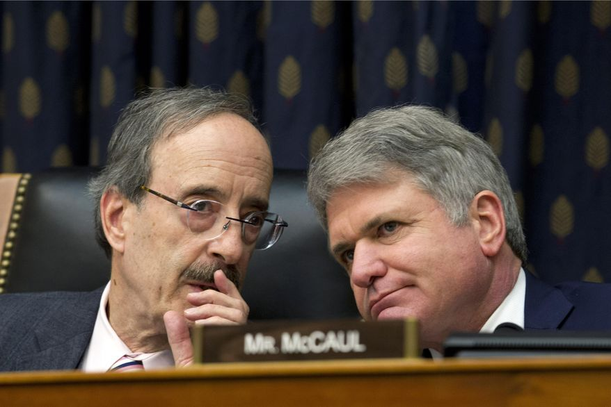 In this Feb. 13, 2019, photo, House Foreign Affairs Committee Chairman Rep. Eliot Engel D-N.Y., left, speaks with Ranking Member Rep. Michael McCaul, R-Texas, during the House Foreign Affairs subcommittee hearing in Washington. (AP Photo/Jose Luis Magana) ** FILE **