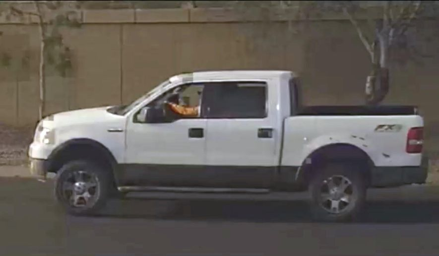 This photo provided by the Phoenix Police Department shows a security video photo of what is believed to be the suspects vehicle in a road rage incident in Phoenix, Ariz. where a 10 year old girl was fatally shot. Sgt. Vince Lewis said the shooting that killed Summerbell Brown occurred Wednesday, April 3, 2019 when a man in a pickup truck that had been following a family's car fired several gunshots after the family pulled into their driveway. (Phoenix Police Department via AP)