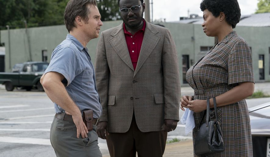 "This image released by STXfilms shows, from left,  Sam Rockwell, Babou Ceesay and Taraji P. Henson in a scene from ""The Best of Enemies."" (Annette Brown/STXfilms via AP)"