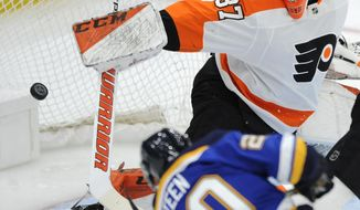 St. Louis Blues' Alexander Steen (20) scores on Philadelphia Flyers' Brian Elliott (37) during the first period of an NHL hockey game, Thursday, April 4, 2019, in St. Louis. (AP Photo/Bill Boyce)