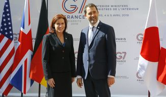 U.S. Homeland Security official Claire Grady, left, is welcomed by French Interior Minister Christophe Castaner for a G7 meeting at ministerial level in Paris, Thursday April 4, 2019. Foreign and interior ministers from the Group of Seven are gathering in France this week to try to find ambitious solutions to world security challenges. Putting a dampener on that are two glaring American absences: U.S. Secretary of State Mike Pompeo and Homeland Security Secretary Kirstjen Nielsen. (AP Photo/Michel Euler)