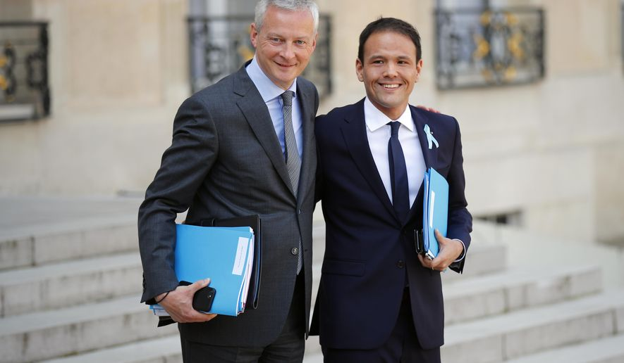 French Economy and Finance Minister Bruno Le Maire, left poses with Cedric O, new junior minister for Digital Affairs as they walk out after the weekly cabinet meeting at the ELysee Palace in Paris, Monday, April 1, 2019. French President Emmanuel Macron has appointed three new government members, including the minister who will be in charge of handling Brexit-related issues. (AP Photo/Francois Mori)