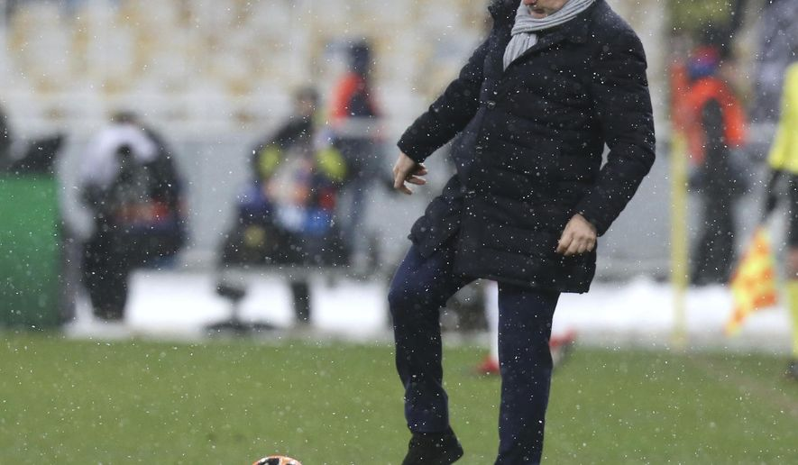 FILE - In this Dec.12, 2018 file photo, Lyon coach Bruno Genesio kicks the ball during the Group F Champions League soccer match between Shakhtar Donetsk and Lyon at the Olympiyskiy stadium, in Kiev, Ukraine. Despite a season marred by many ups and downs and the hostility of many fans, the Lyon coach Bruno Genesio had reportedly reached a deal with president Jean-Michel Aulas for a two-year contract extension.(AP Photo/Efrem Lukatsky, File)