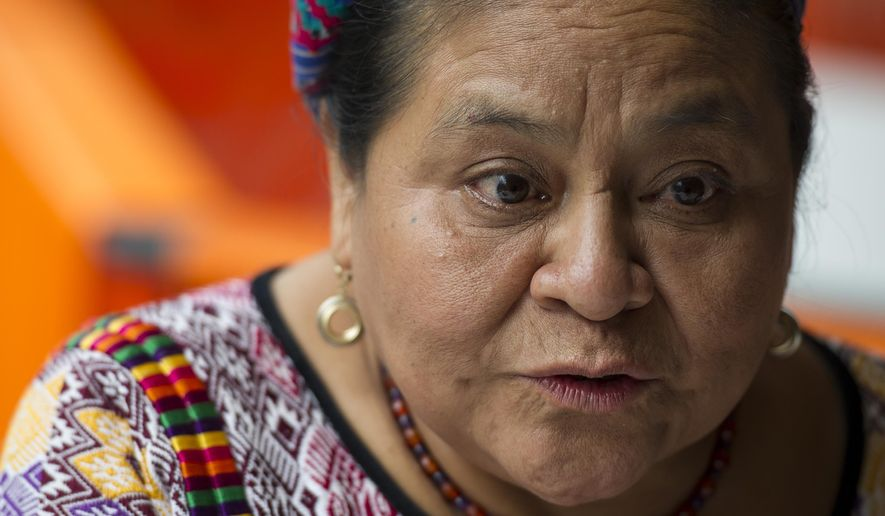 FILE - In this Aug. 17, 2016 file photo, Nobel Peace Prize laureate Rigoberta Menchu speaks during an interview in Mexico City. Menchu, along with other Nobel prize winners, expressed their concern on Thursday, April 4, 2019, for the political and human rights situation in Guatemala, which they believe is deteriorating.  (AP Photo/Nick Wagner, File)