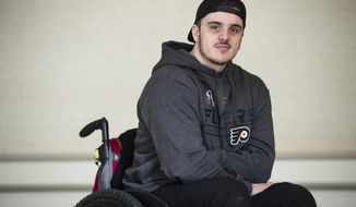 In this Wednesday, March 20, 2019 photo, Ryan Straschnitzki poses for a photograph in Philadelphia, Straschnitzki, a young hockey player was paralyzed in the Humboldt Broncos bus crash in Canada. (AP Photo/Matt Rourke)
